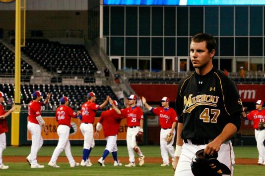 Mizzou baseball player leaving field after losing to Kansas.