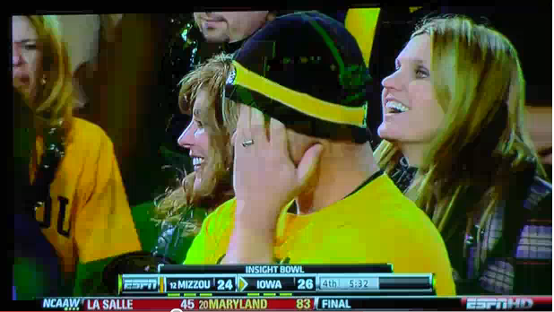 Mizzou fan hides face at Insight Bowl