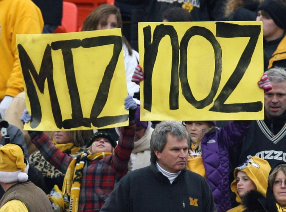 Mizzou fans hold up mispelled signs