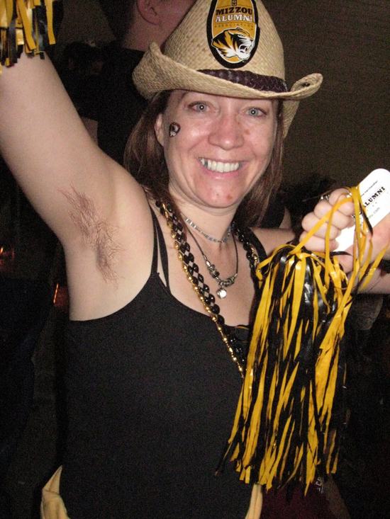 Female Mizzou fan with arm pit hair.
