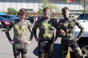 Three horribly painted Mizzou freshmen.