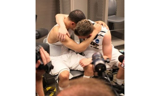 Two Tigers cry after their epic loss to 15 seed Norfolk St. in the first round of the 2012 NCAA tournament.