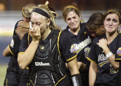 Mizzou softballs players crying after a playoff loss.