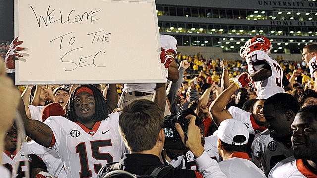 Georgia football player holds up sign after they thorough beat down Mizzou.