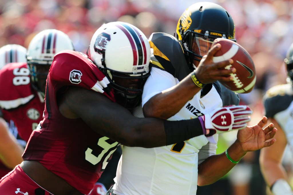 A USC pass rusher hits Mizzou QB James Franklin just as he is about to throw